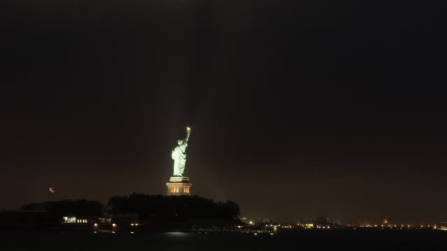 Time Lapse of clouds and Statute of Liberty at night