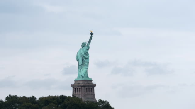 Time Lapse of clouds and Statute of Liberty