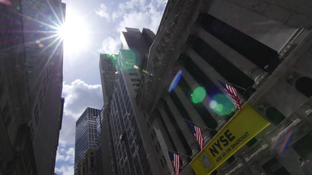 time lapse of clouds and sun in wall street new york city - new york stock exchange stock videos & royalty-free footage