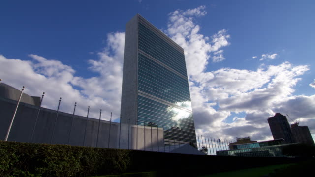 time lapse of clouds and united nations building - united nations building stock videos and b-roll footage