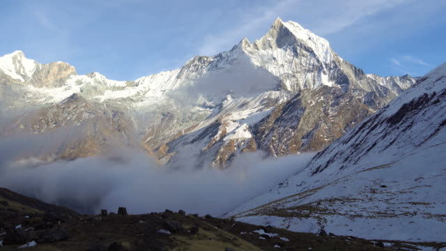 time lapse of clouds around the machapuchare from annapurna base camp in nepal - nepal stock videos & royalty-free footage