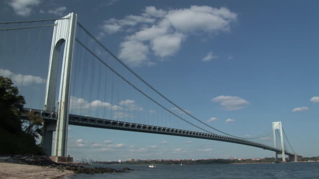 time lapse of clouds, boats, waves and traffic moving quickly around the verrazano-narrows bridge during the day  - staten island stock videos and b-roll footage