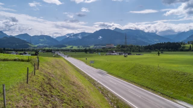time lapse of clouds, busy road and trautenfels castle, styria, austrian alps, austria, europe - traditionally austrian stock videos & royalty-free footage