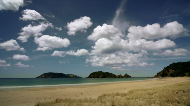 Time lapse of clouds drifting over beach / Great Barrier Island, New Zealand