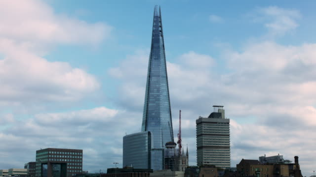 time lapse of clouds drifting past the shard on a sunny day - shard london bridge stock videos & royalty-free footage