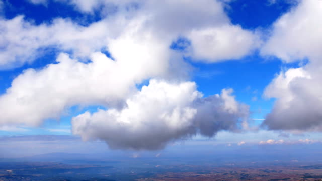 time lapse of clouds from a high altitude mountain - cumulus stock videos & royalty-free footage