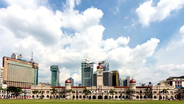 time lapse of clouds moving above kuala lumpur skyline in malaysia - sultan abdul samad building stock videos & royalty-free footage