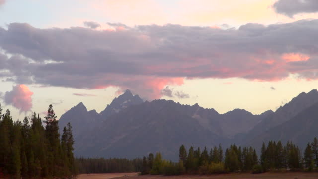time lapse of clouds moving on top of the mountains of grand teton national park - grand teton national park stock videos & royalty-free footage