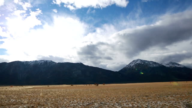 Time lapse of clouds moving over mountain range