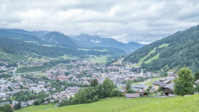 time lapse of clouds moving over schladming, styria, austrian alps, austria, europe - traditionally austrian stock videos & royalty-free footage