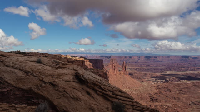 a time lapse of clouds moving over the colorado river canyonlands of utah usa - river colorado stock videos & royalty-free footage