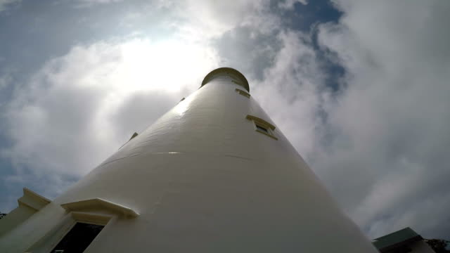 time lapse of clouds over light house on fraser island - concepts stock videos & royalty-free footage