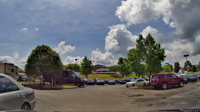 time lapse of clouds over parking lot at the mercedesbenz dealership in nashville tennessee usa amid the 2020 global coronavirus pandemic - moody sky stock videos & royalty-free footage