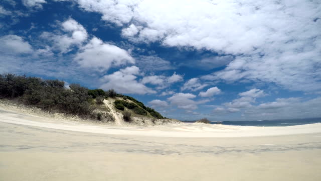 time lapse of clouds over sand dunes on fraser island - sand dune stock videos & royalty-free footage