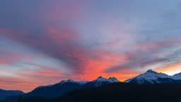 Time lapse of clouds over Tantalus Range in BC Canada at colorful sunset UHD