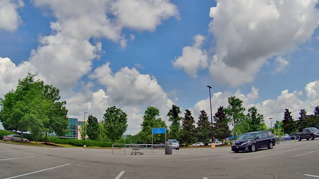 time lapse of clouds over the walmart shopping center in nashville tennessee amid the 2020 global coronavirus pandemic - moody sky stock videos & royalty-free footage