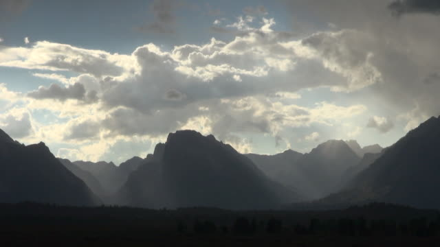time lapse of clouds passing above mountains of grand teton national park - grand teton national park stock videos & royalty-free footage