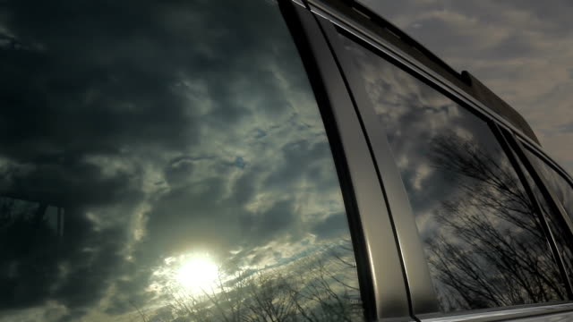 Time Lapse of Clouds Refection on Car Window