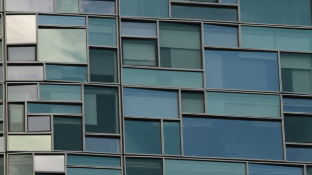 Time Lapse of clouds reflecting on windows of 100 11th Ave