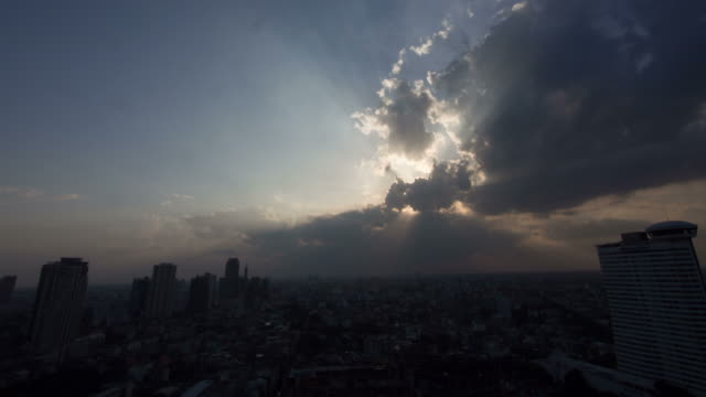 Time lapse of cloudscape with bright sun shining with clouds