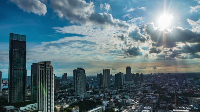 Time lapse of cloudscape with bright sun shining with clouds -