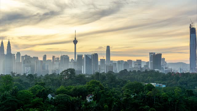 4k time lapse of cloudy sunrise over downtown kuala lumpur - menara kuala lumpur tower stock videos & royalty-free footage
