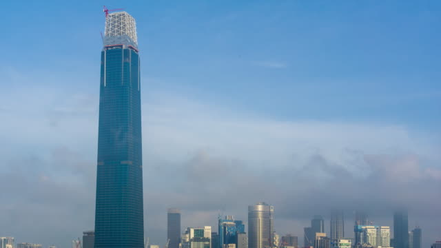 4K Time lapse of cloudy sunrise over Exchange 106 tower. The tower still under construction and will become highest tower in Malaysia.