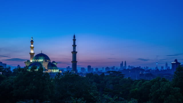 4K Time lapse of cloudy sunrise over Federal Mosque of Kuala Lumpur in Malaysia.