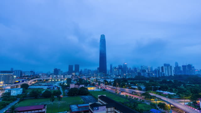 4K Time lapse of cloudy sunset over Exchange 106 tower. The tower still under construction and will become highest tower in Malaysia.