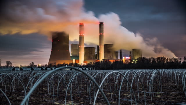 time lapse of coal fired power station at night - tracking shot - coal fired power station stock videos and b-roll footage