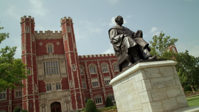 """time lapse of collegiate building with bronze statue, """"george lynn cross"""" - oklahoma stock videos & royalty-free footage"""