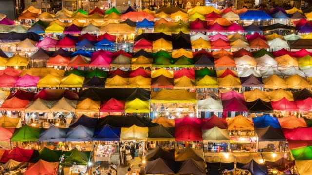 time lapse of colorful night market - retail occupation stock videos & royalty-free footage