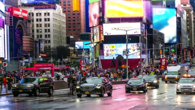 time lapse of colorful times square, new york - yellow taxi video stock e b–roll