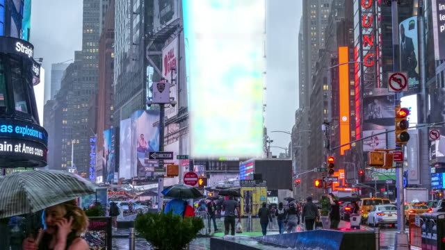 time lapse of colorful times square, new york - yellow taxi stock videos & royalty-free footage