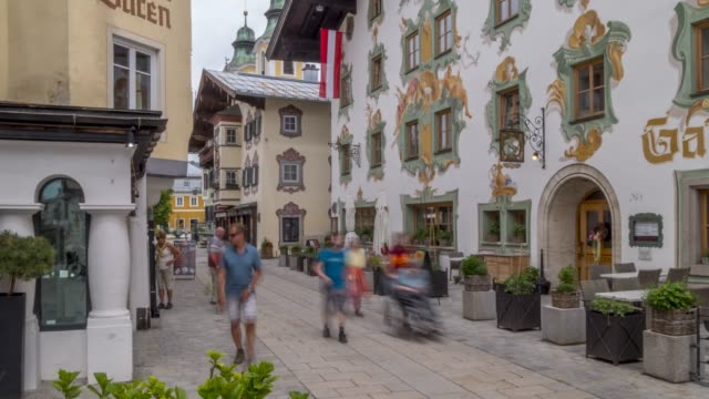 time lapse of colourful architecture on speckbackerstrassa in st. johann in tirol, austrian tyrol, austria, europe - traditionally austrian stock videos & royalty-free footage