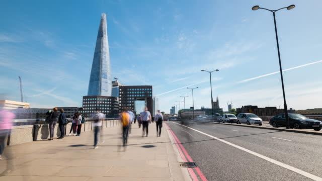 london: time lapse of commuter on london bridge - shard london bridge stock videos & royalty-free footage