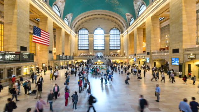 ws time lapse of commuters at grand central station - station stock-videos und b-roll-filmmaterial