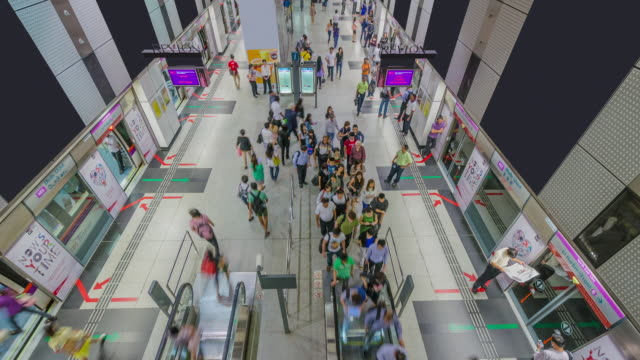 Time Lapse of Commuters exiting Dhoby Ghaut Platform, Singapore, Singapore.
