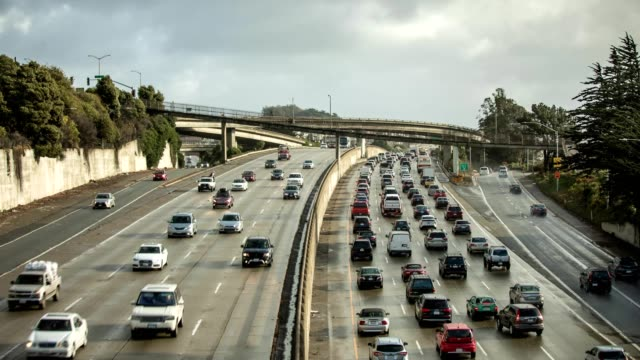 time lapse of congested freeway in the morning - traffic time lapse stock videos & royalty-free footage