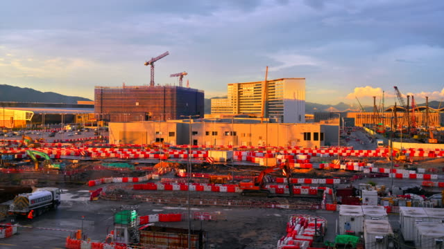 time lapse of construction building with cranes and derrick and blue sky in the city - interconnect plug stock videos & royalty-free footage