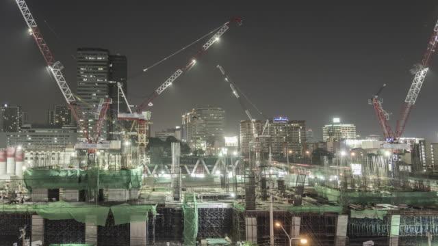 時間の経過の工事現場でのご宿泊 - 建物の骨組み点の映像素材/bロール