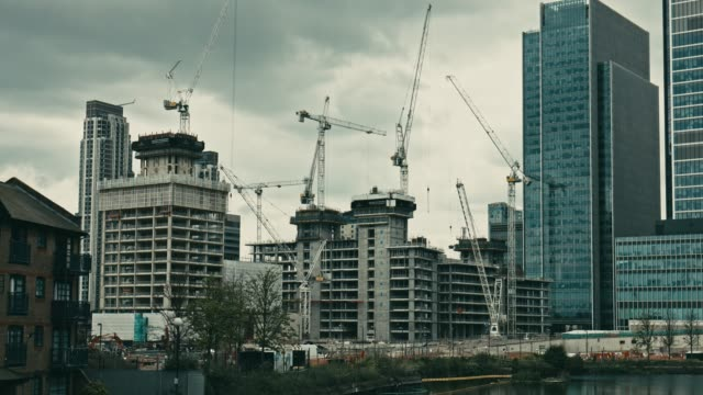 time lapse of construction site of a new development in canary wharf, london - uk stock videos & royalty-free footage