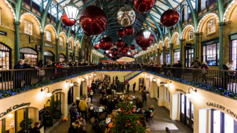 london - circa 2012: time lapse of covent garden market during christmas time, with band playing for people, in london - holiday event stock videos & royalty-free footage