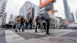 Time lapse of crosswalk at four-way intersection near Dundas Square in Downtown Toronto