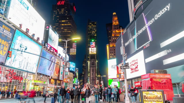 4k time lapse of crowd anonymous tourist walking and visiting times square area at twilight time, new york, united states, usa, travel and landmark with business concept - fast motion stock videos & royalty-free footage
