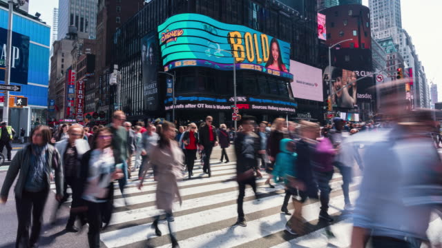 4k time lapse of crowd anonymous tourist walking and visiting times square area in new york, united states - broadway manhattan stock videos & royalty-free footage