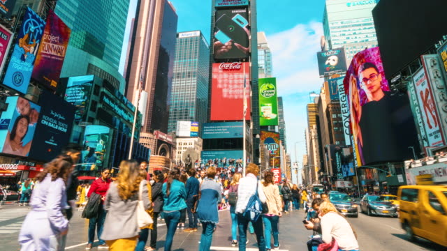 4k time lapse of crowd anonymous tourist walking and visiting times square area, new york, united states, usa, travel and landmark with business concept - fast motion stock videos & royalty-free footage