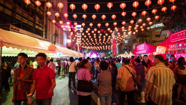 time lapse of crowd at yaowarat road during night - chinese culture stock videos and b-roll footage