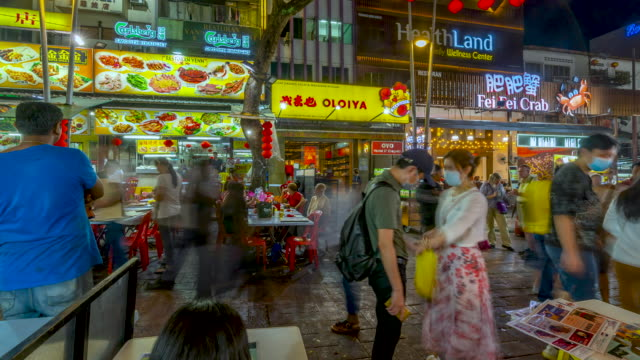 time lapse of crowd of people walking in the local night market . kuala lumpur, malaysia - kuala lumpur stock videos & royalty-free footage