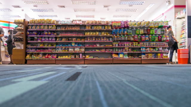 time lapse of crowd shopping at convenience store - shelf stock videos and b-roll footage